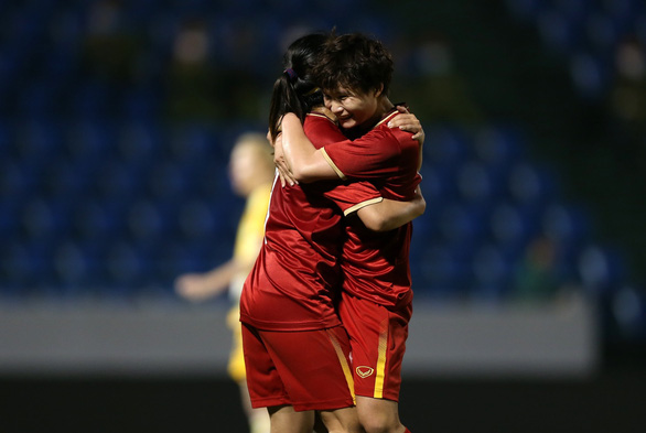 Vietnam's Huynh Nhu (R) hugs a teammate after scoring their first-ever goal against Australia in their second-leg play-off for a ticket to the Tokyo 2020 Olympics women's football tournament in Quang Ninh Province, Vietnam, March 11, 2020. Photo: Nam Khanh / Tuoi Tre