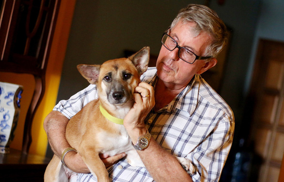 American Michael Abadie and one of his dogs in Ho Chi Minh City, Vietnam. Photo: Ngoc Hien / Tuoi Tre