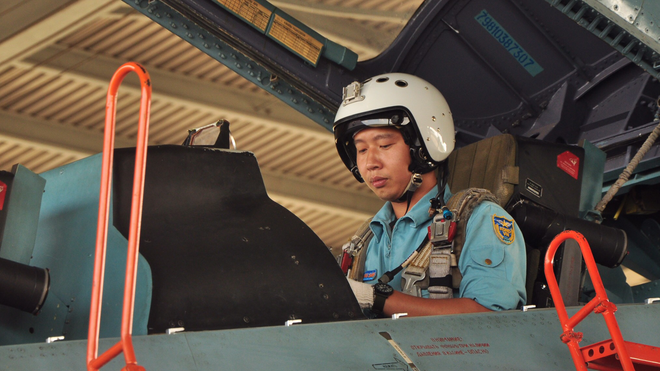 Vietnamese fighter jet pilot Nguyen Quang Sang prepares to fly a Su-30MK2 aircraft in this provided photo.