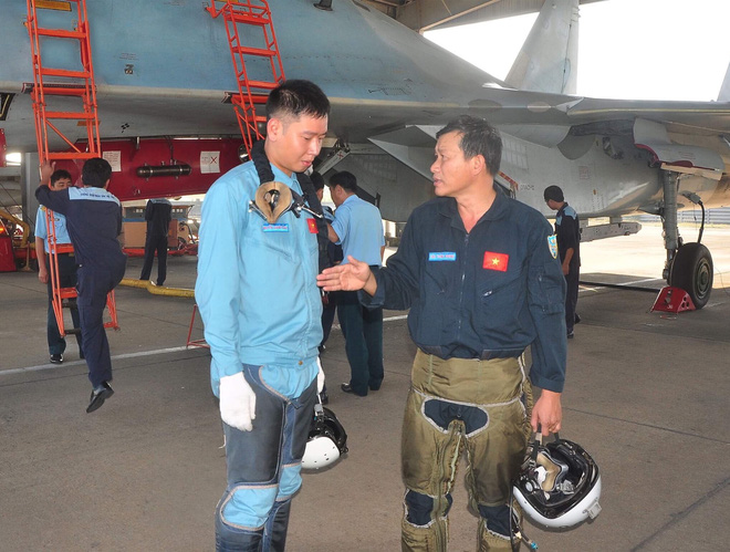 Vietnamese fighter jet pilot Nguyen Quang Sang (left) and his instructor are seen in this provided photo.
