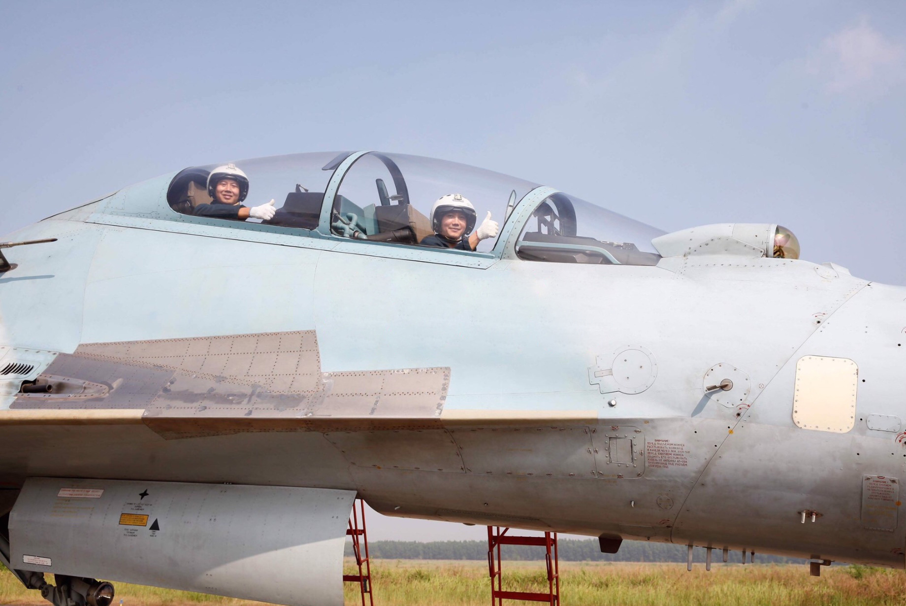 Vietnamese fighter jet pilot Nguyen Quang Sang (left) prepares to fly a Su-30MK2 aircraft in this provided photo.