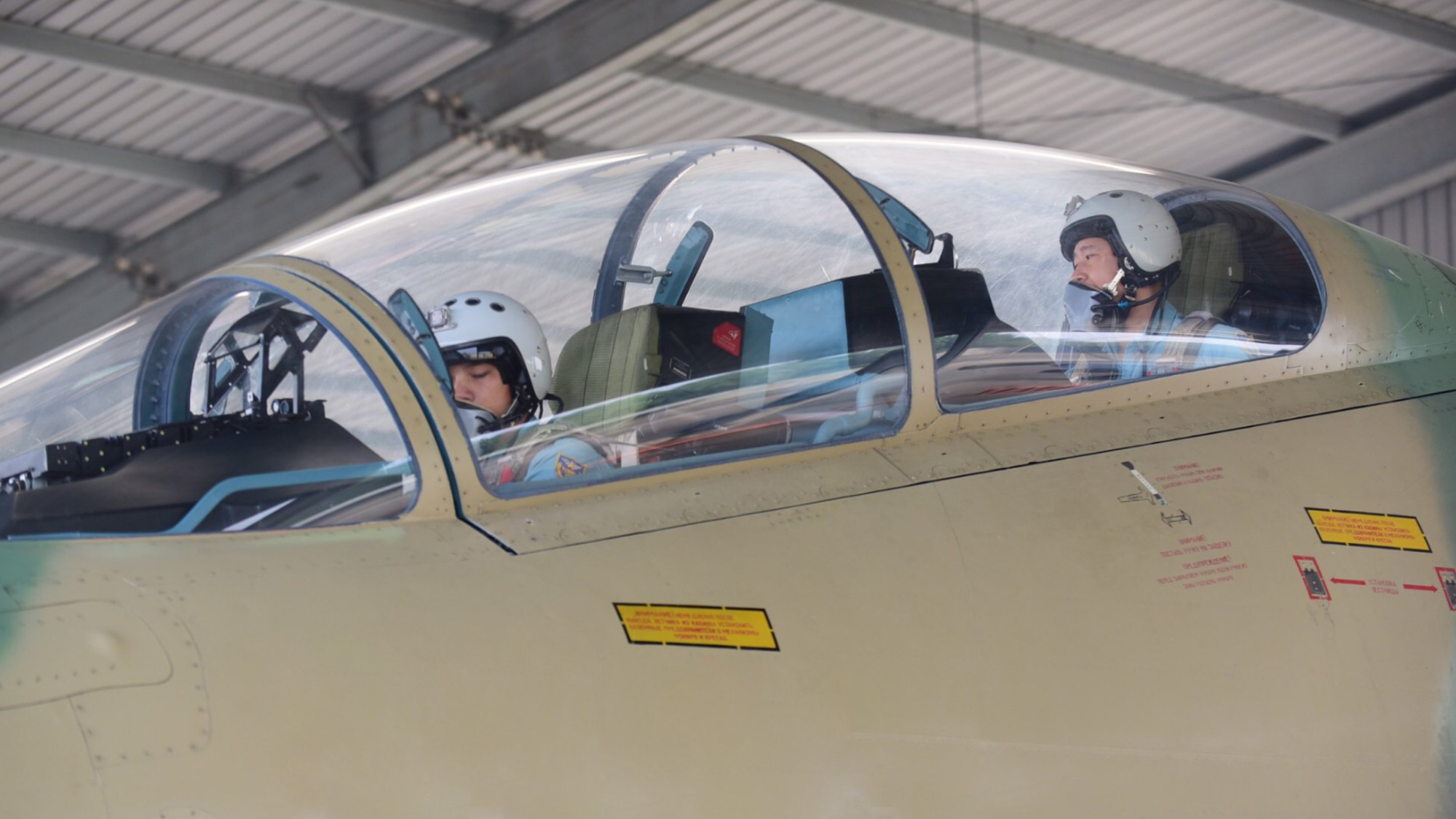 Vietnamese fighter jet pilot Nguyen Quang Sang (right) prepares to fly a Su-30MK2 aircraft in this provided photo.