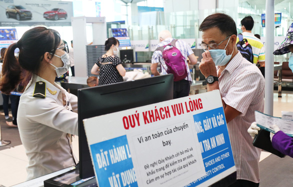 Vietnam mandates that people wear face masks at airports, bus stations, supermarkets amid COVID-19