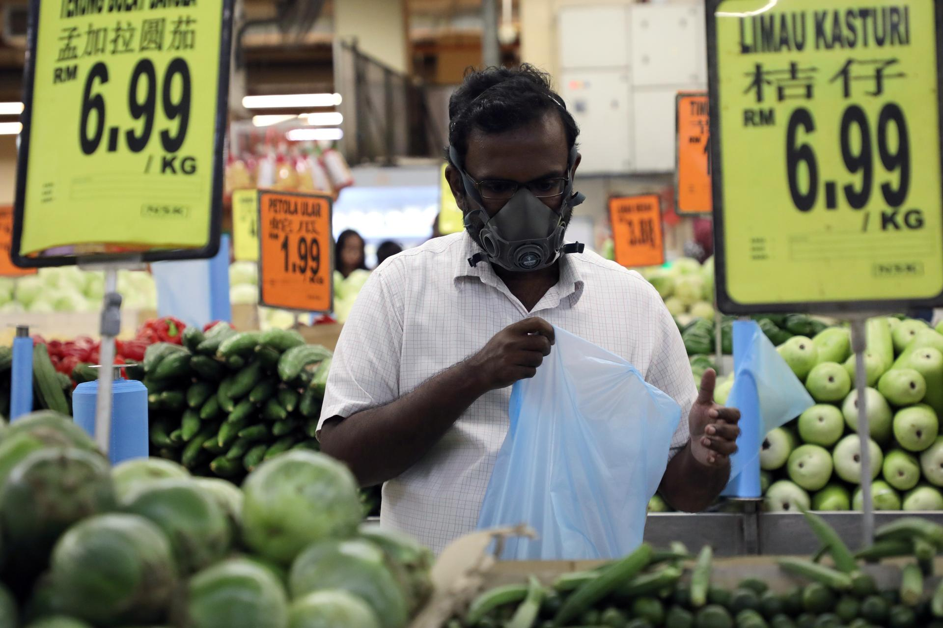 Malaysia reports 190 new coronavirus cases, most linked to mosque event