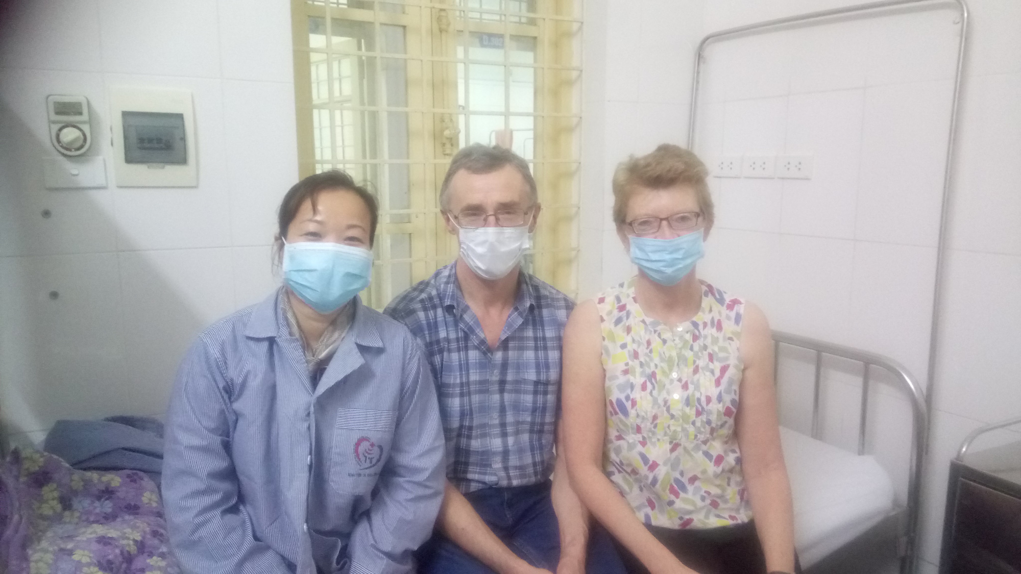 Cath and David Butler are seen with N.T.H.L. at Dong Da General Hospital in Hanoi, Vietnam in this supplied photo.