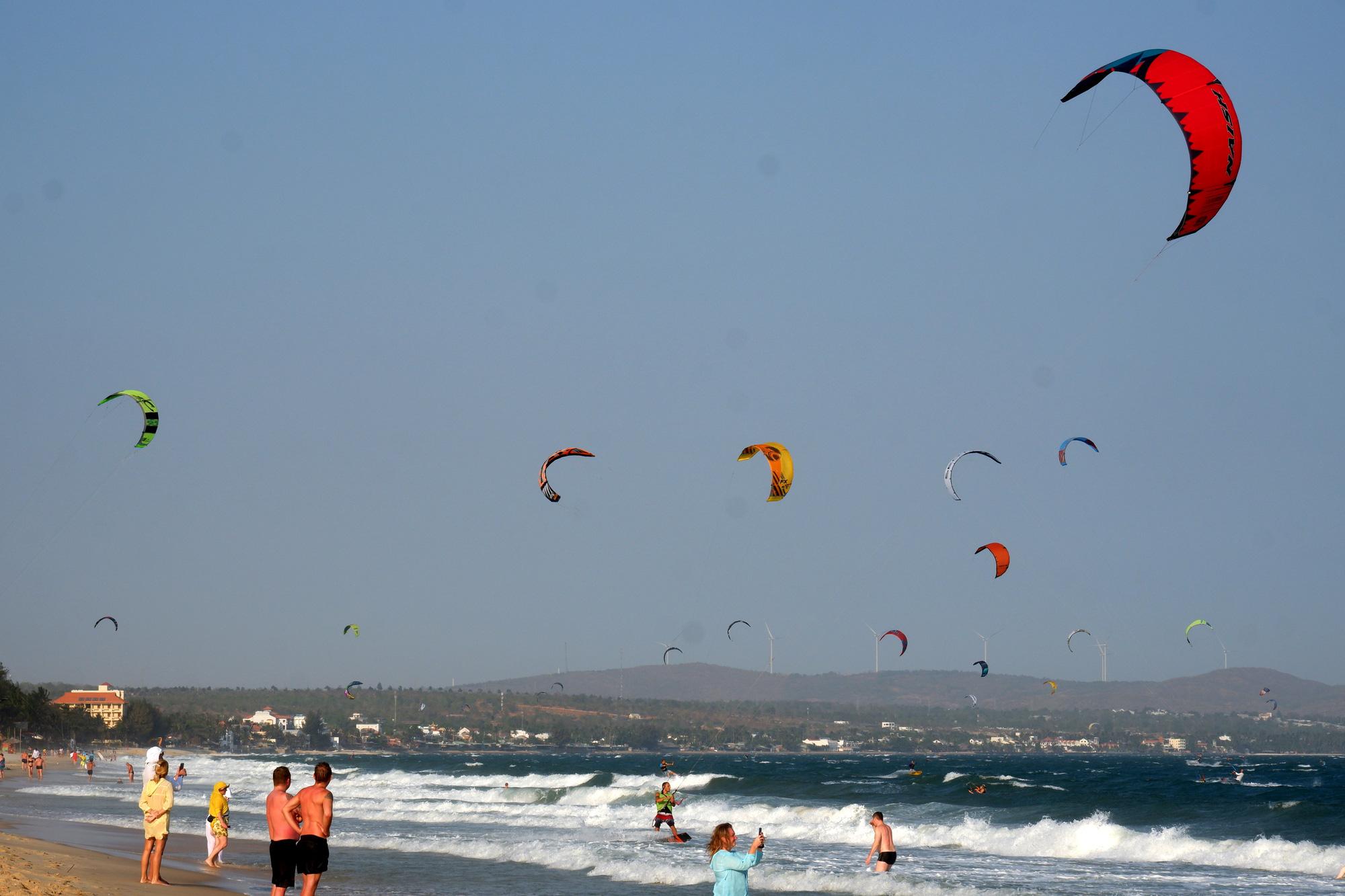 Kite surfers crowd beach in Binh Thuan, Vietnam's COVID-19 epicenter