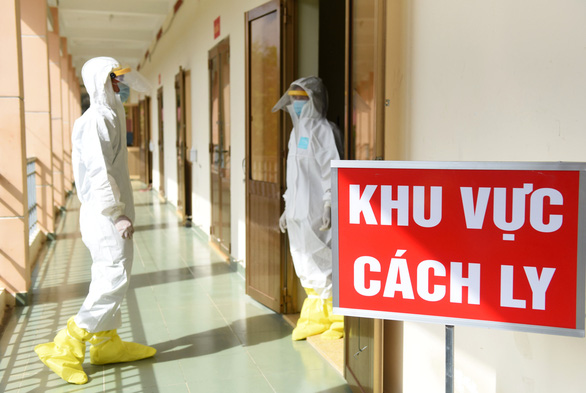Two medical workers in protective suits are seen at a centralized COVID-19 quarantine facility in Ho Chi Minh City in this undated photo. Photo: Duyen Phan / Tuoi Tre