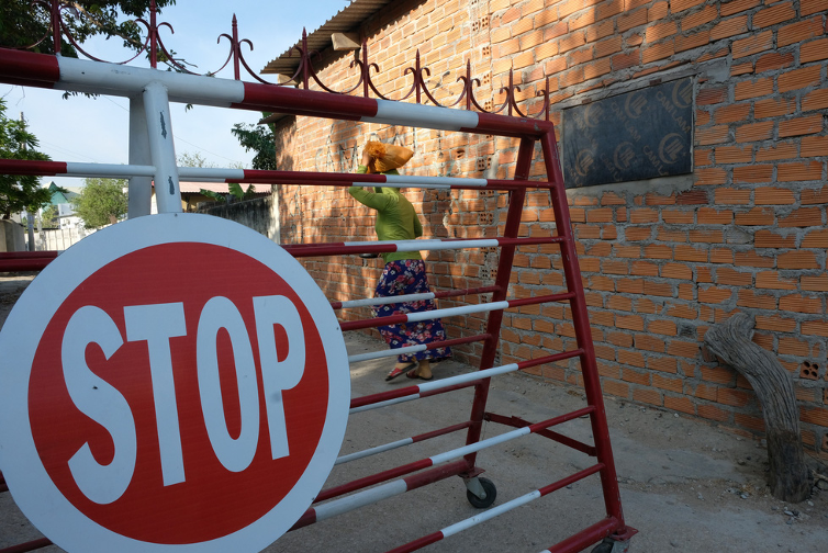 An entrance to Van Lam 3 Village in Ninh Thuan Province, Vietnam is barricaded. Photo: Dinh Cuong / Tuoi Tre