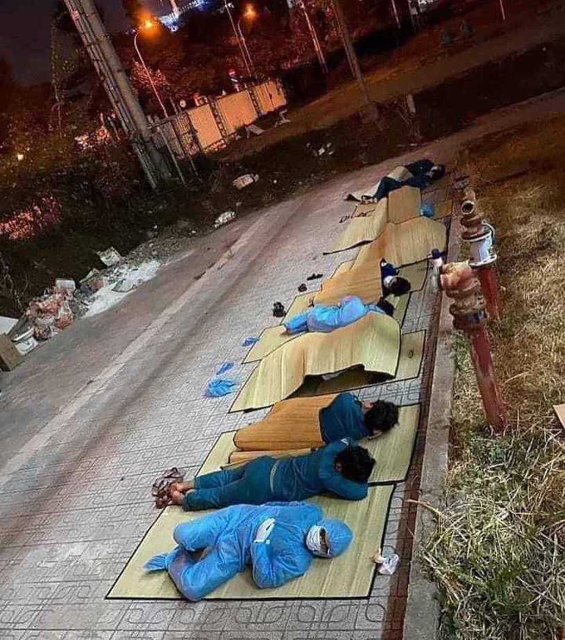 Volunteers sleep on the ground of a quarantine facility in Binh Duong Province, Vietnam in this photo posted to the verified Facebook page of Bobby Chinn on March 22, 2020.