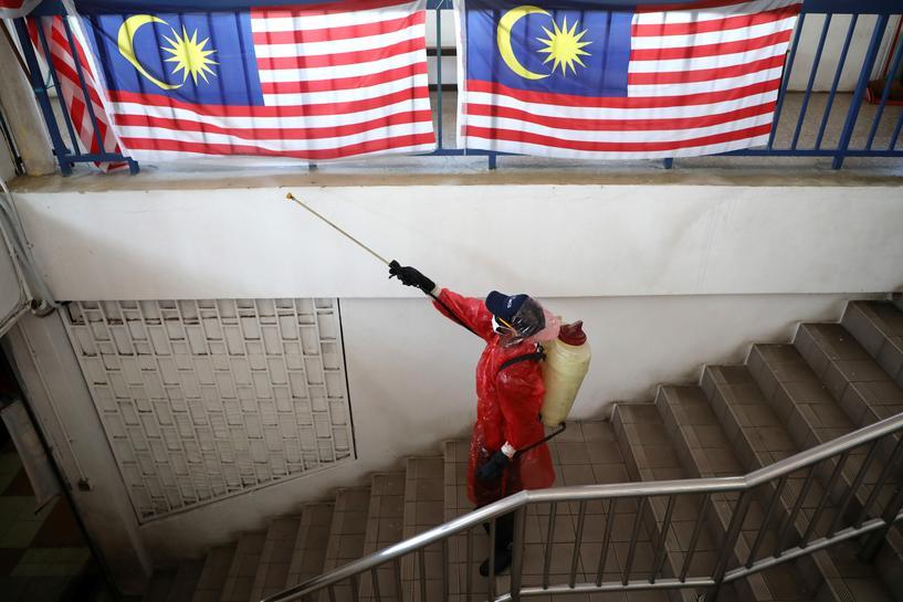 Malaysia extends movement curbs, prepares economic stimulus as coronavirus cases surge