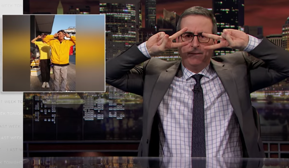 A screenshot shows host John Oliver dance to Quang Dang's Handwashing Dance on Last Week Tonight program in March, 2020.