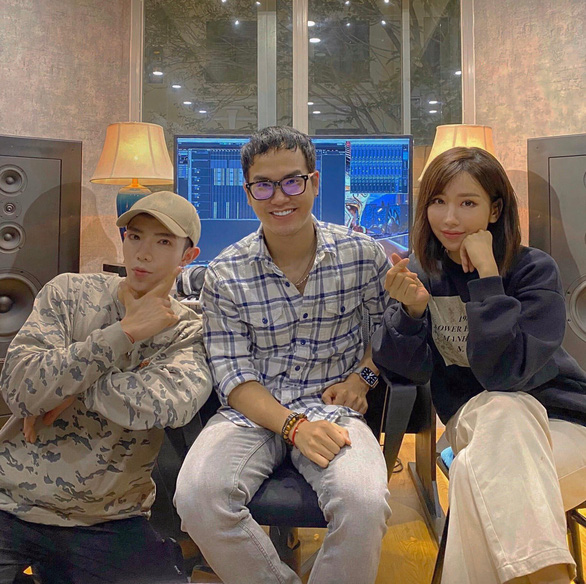 Khac Hung (C) with singers Min (R) and Erik are seen in a photo posted on Erik's verified Facebook account
