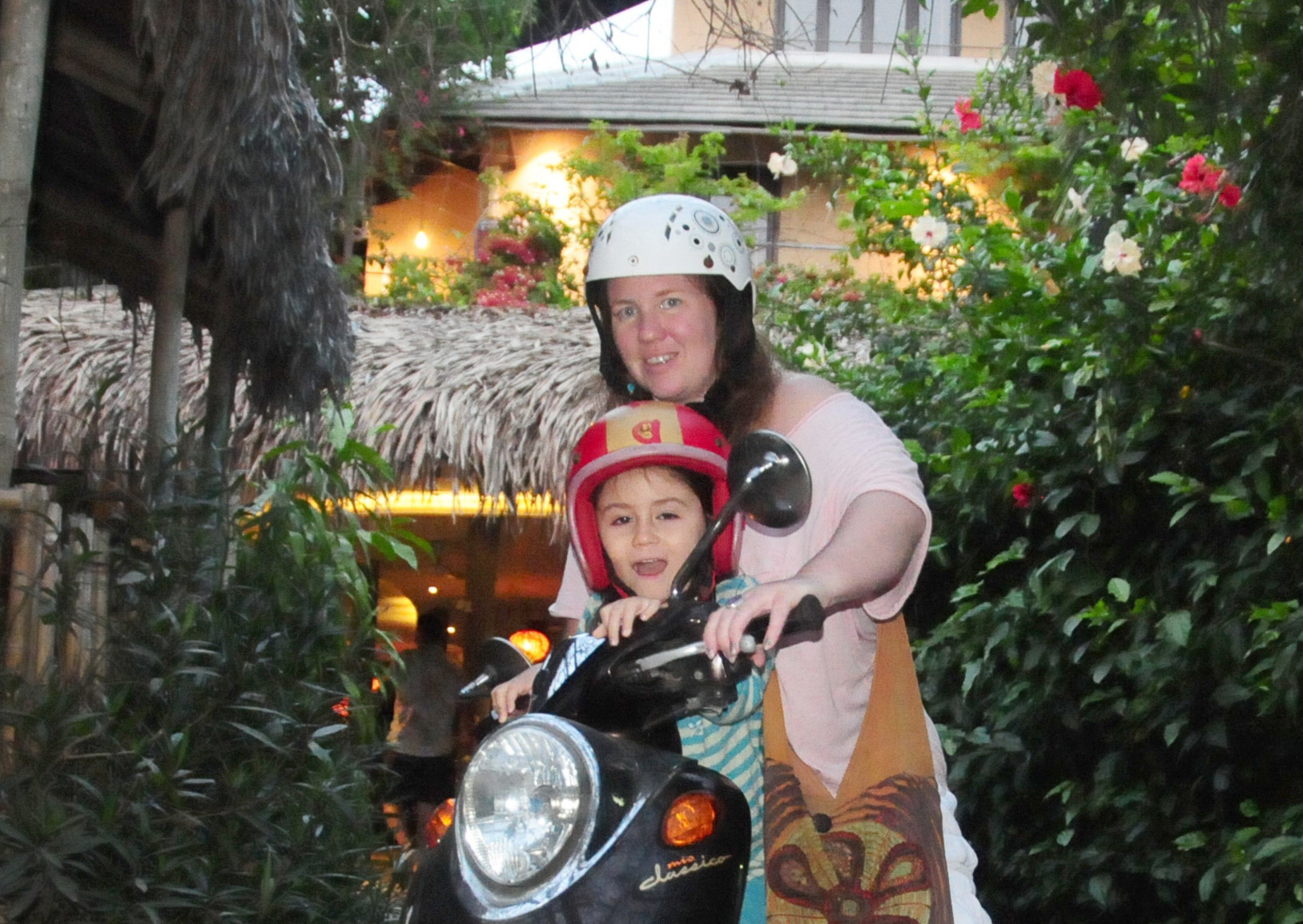 A foreign tourist and her son ride a motorbike at An Villa in Cam Thanh Commune, Hoi An City, Quang Nam Province, Vietmam. Photo: Quoc Viet / Tuoi Tre
