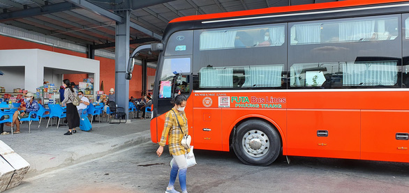 A passenger bus is parked at a bus station in the Mekong Delta city of Can Tho, Vietnam. Photo: Le Dan / Tuoi Tre