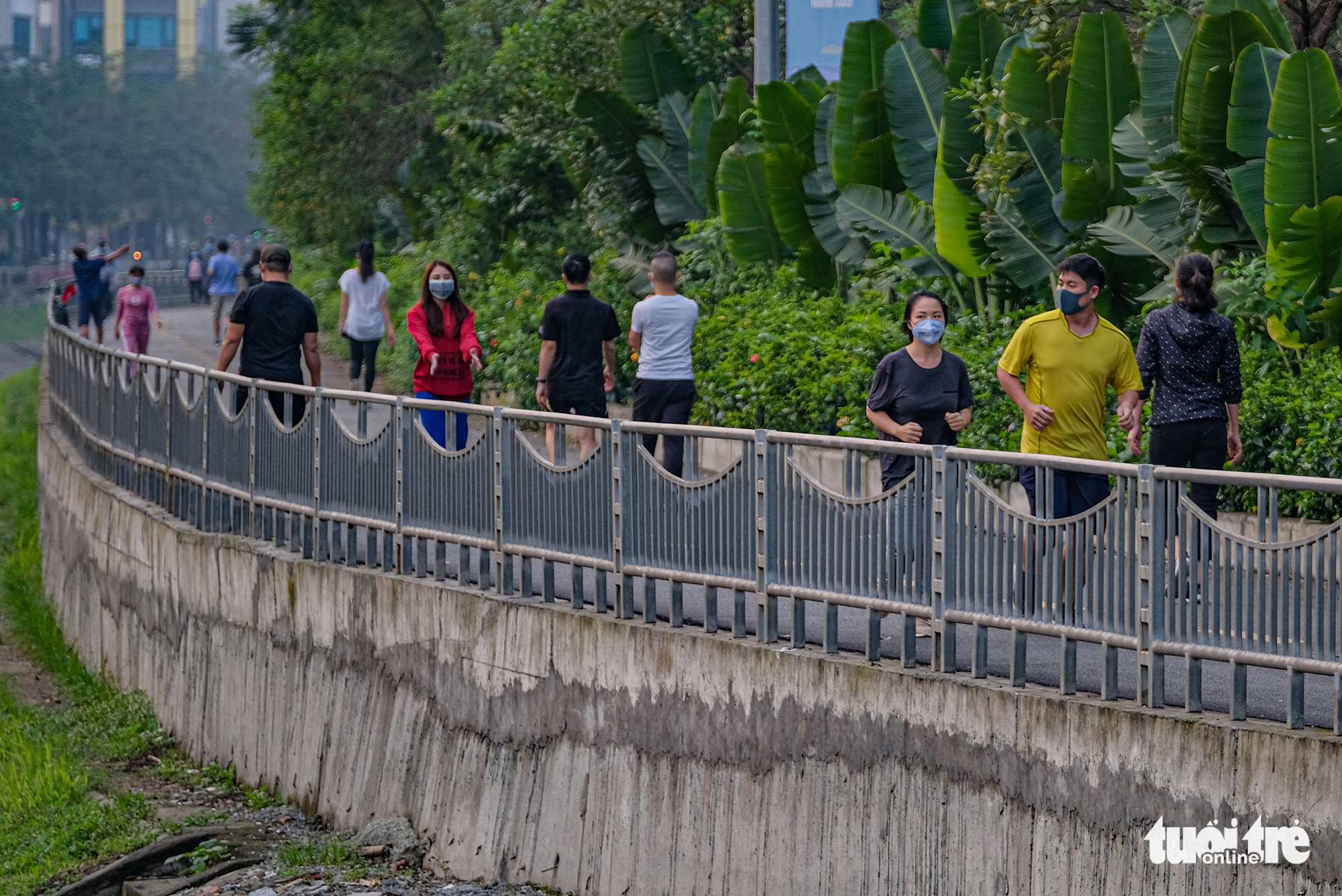 Residents exercise on a pedestrian lane of Lang Street along To Lich River in Hanoi, Vietnam in this photo taken in early April 2020. Photo: Nam Tran / Tuoi Tre