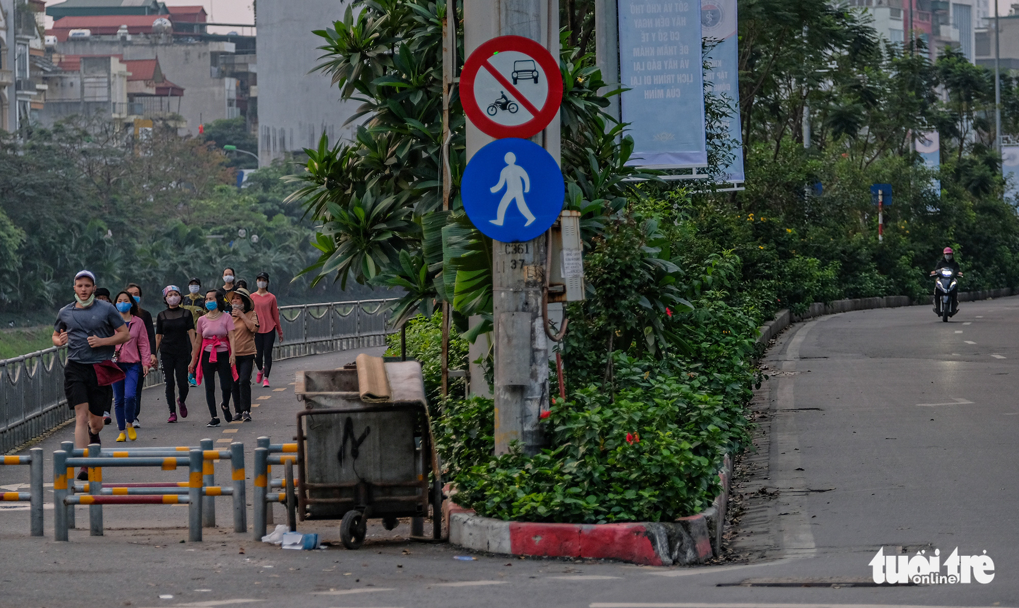 Residents exercising on a pedestrian lane of Lang Street along To Lich River in Hanoi, Vietnam outnumber vehicles on the street in this photo taken in early April 2020. Photo: Nam Tran / Tuoi Tre