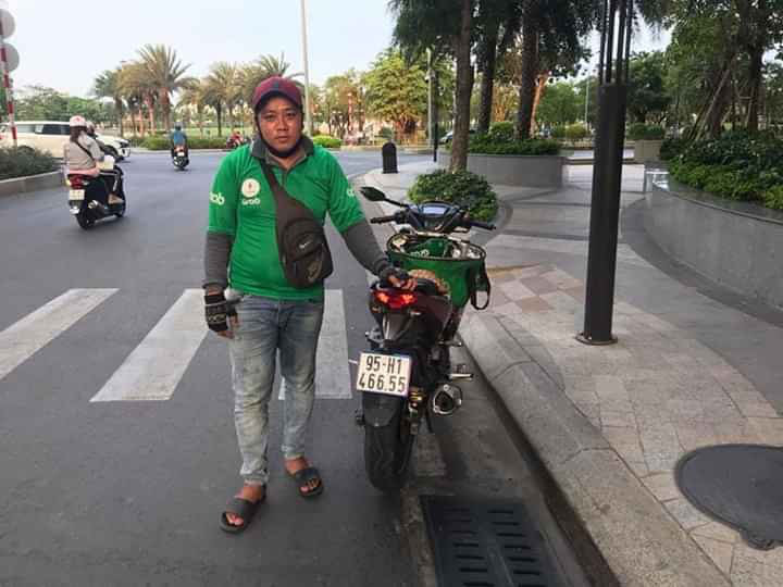 GrabBike driver saves woman from jumping off bridge