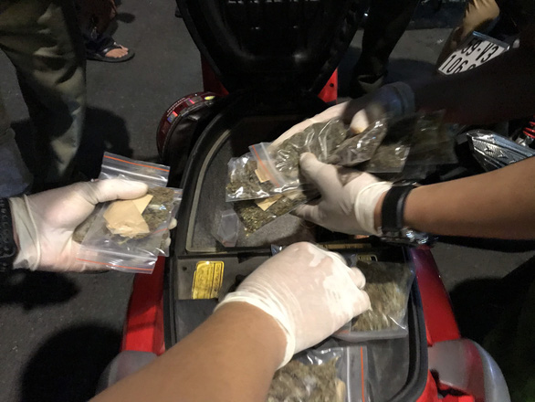 Packets of cannabis are found inside a foreign man's scooter in District 1, Ho Chi Minh City, April 10, 2020. Photo: Dan Thuan / Tuoi Tre
