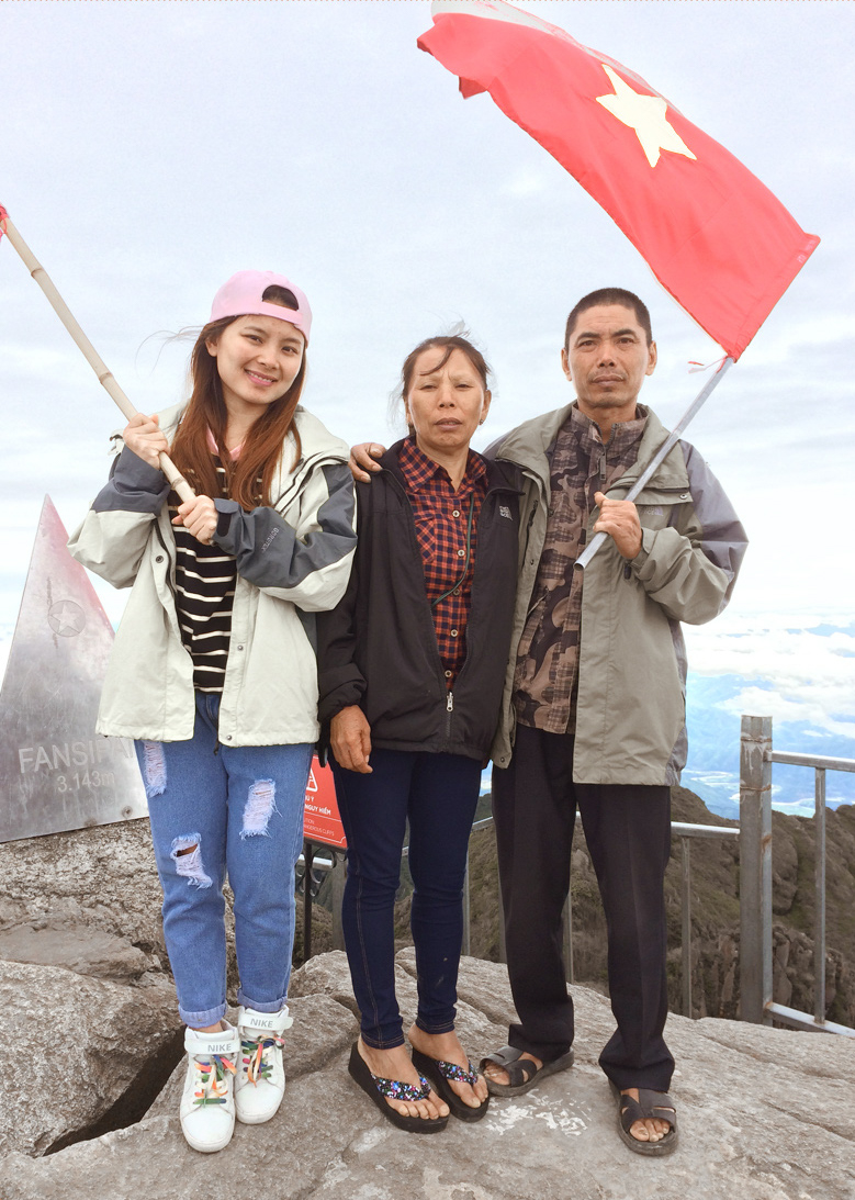 Chao Yen (left) and her parents are seen on top of Mount Fansipan in northern Vietnam in this supplied photo.