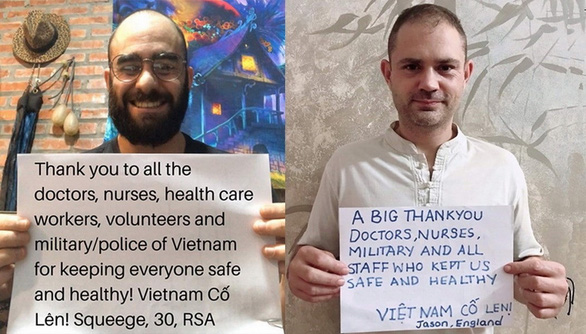<em>South Africa's Gianluigi Squeege Nicolosi (left) and British teacher Jason Bonne-Gray pose for photos with their thank-you messages to Vietnam's frontline forces in the COVID-19 battle in these supplied pictures.</em>