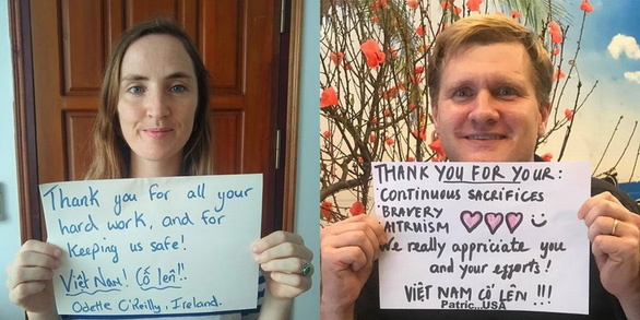 <em>Ireland's Odette O'Reilly (left) and American veteran Patrick Furman pose for photos with their thank-you messages to Vietnam's frontline forces in the COVID-19 battle in these supplied pictures.</em>