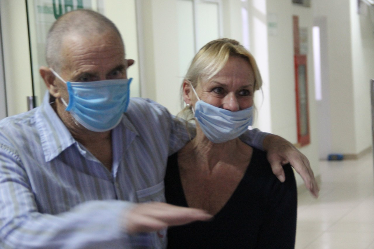 Dixong John Garth and his wife are pictured at the National Hospital for Tropical Diseases in Hanoi, Vietnam in this photo supplied by the infirmary.