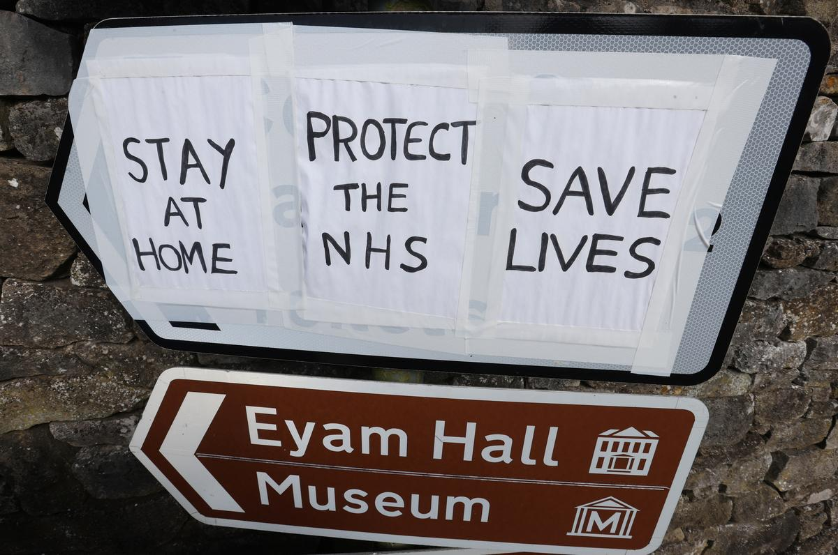 Signs asking for people to stay at home are seen in Eyam, as the spread of the coronavirus disease (COVID-19) continues, Eyam, Britain, April 13, 2020. Photo: Reuters