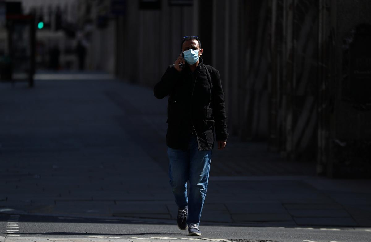 A man wearing a protective face mask is seen in Regent Street, as the spread of the coronavirus disease (COVID-19) continues, London, Britain, April 13, 2020. Photo: Reuters