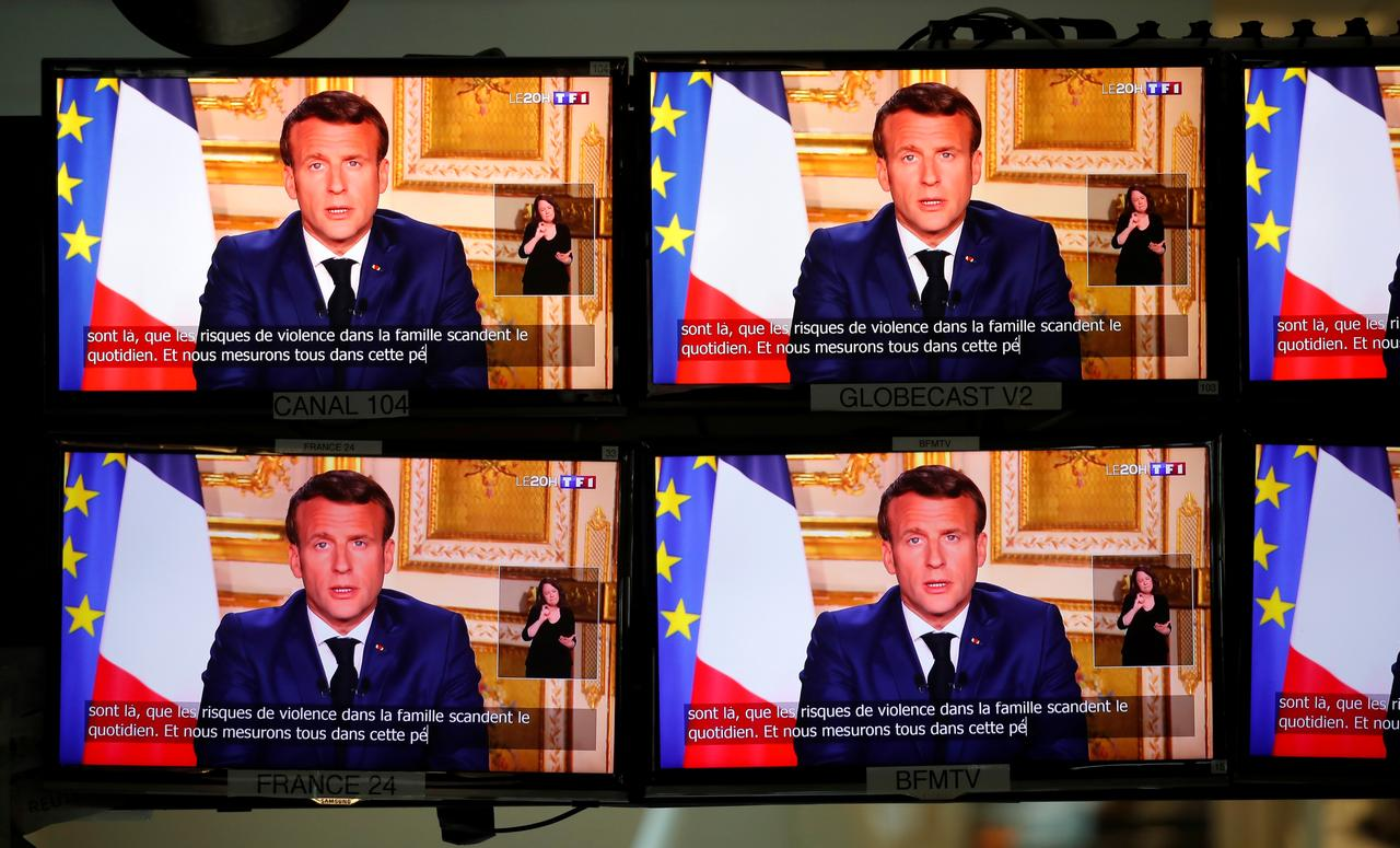 French President Emmanuel Macron is seen as he addresses the nation about the coronavirus disease (COVID-19) outbreak, on television screens in Paris, France, April 13, 2020. Photo: Reuters