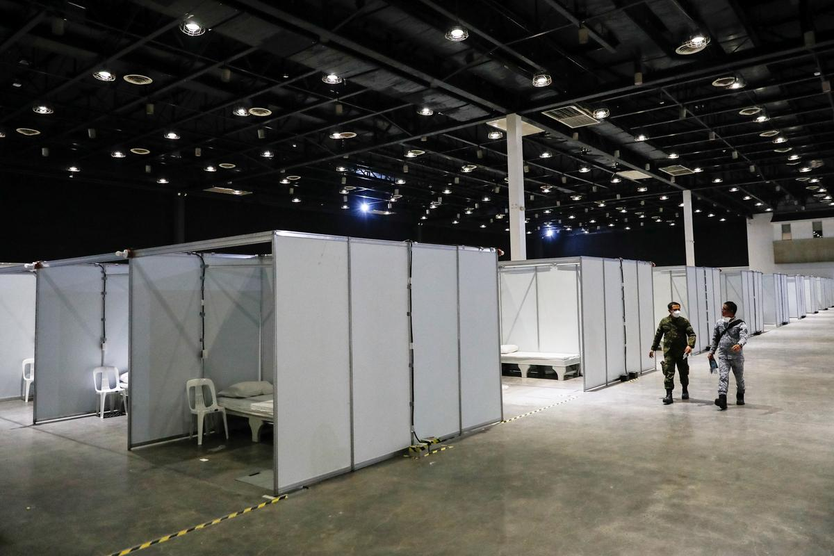 FILE PHOTO: Soldiers walk inside World Trade Center Metro Manila, an exhibition center temporarily turned into a quarantine facility for coronavirus disease (COVID-19) patients in Manila, Philippines, April 13, 2020. Photo: Reuters
