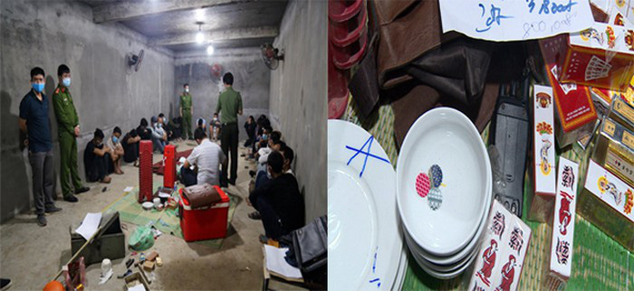 Arrested suspects and confiscated exhibits of a gambling ring in Vinh Phuc Province, Vietnam are seen in this photo supplied by police officers.