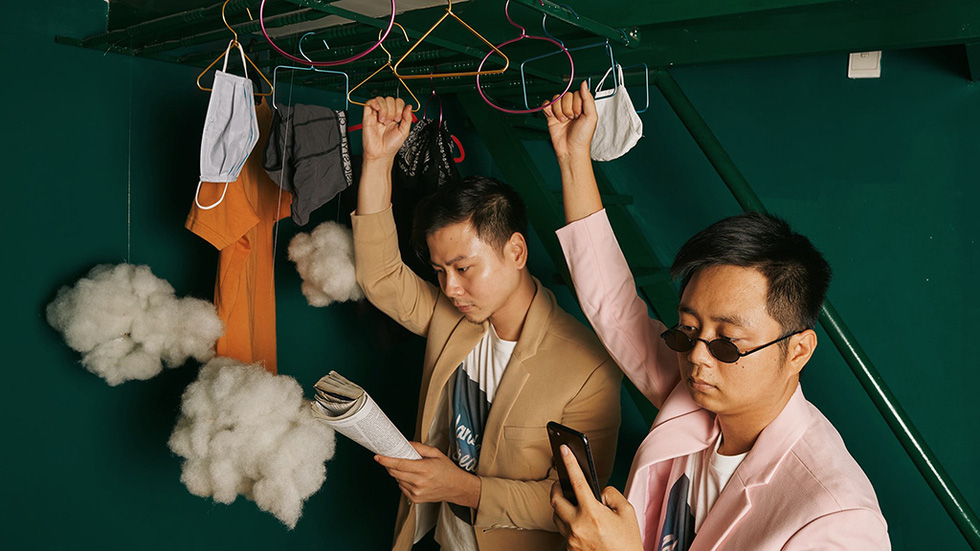 Trung Duc and Khai Quan are seen riding a train to Raohe night market in Taiwan's Taipei in their imaginary 'Lost at Home' photo collection in which they staged their house into world scenes.