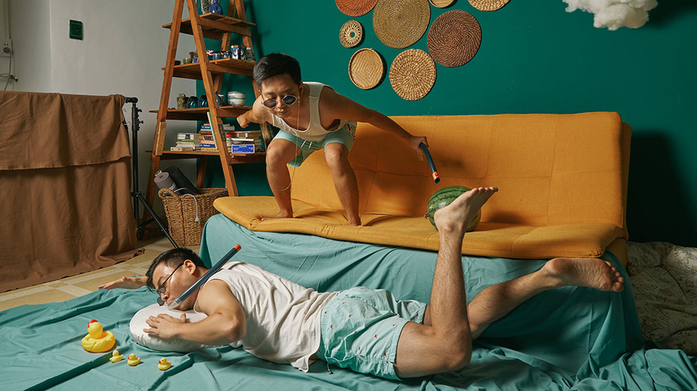 Trung Duc and Khai Quan enjoy the beach in Thailand's Phuket in their imaginary 'Lost at Home' photo collection in which they staged their house into world scenes.