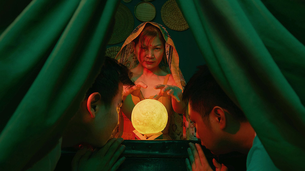 Trung Duc and Khai Quan visit a fortune teller in India, played by Duc's mother, in their imaginary 'Lost at Home' photo collection in which they turned their house into world scenes.