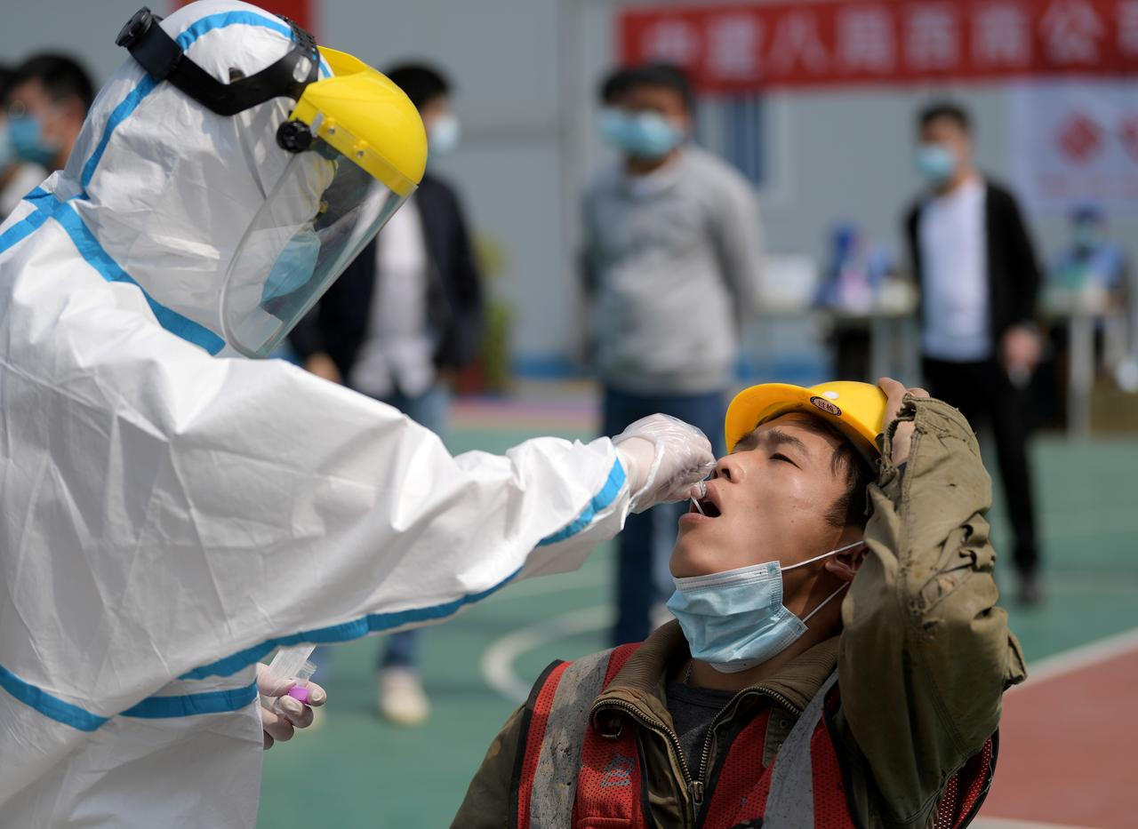 China says nearly 1,300 virus deaths not counted in Wuhan, cites early lapses