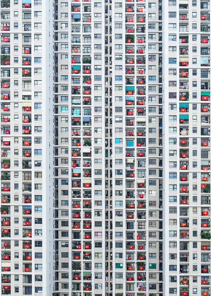 A photo taken by Prabu Mohan on April 19, 2020 featuring a building in Hanoi festooned with Vietnamese national flags as residents want to show support for people who are fighting against the novel corona virus (COVID-19) disease. Photo: Supplied