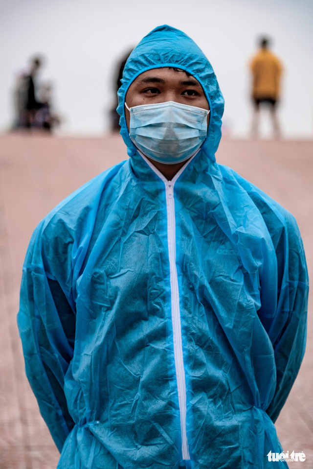 Vuong Thanh Nam in his blue protective gear is seen in this photo taken at a COVID-19 quarantine facility in Hanoi, Vietnam. Photo: Nam Tran / Tuoi Tre