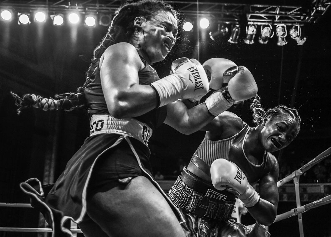 The photo 'Shields strikes back' by Terrell Groggins wins the American Experience award of the 17th annual Smithsonian magazine photo contest. In the photo, Olympic champion Claressa Shields (right) meets Hanna Gabriels in a boxing match at the Masonic Temple in Detroit, Michigan on June 22, 2018. Shields suffered a first-round knock-down by Gabriels — the first time that had happened in Shields' career — but went on to win the match by unanimous decision. Shields is the first American woman to win an Olympic gold medal in boxing, and the first (male or female) to win a gold back-to-back in successive Olympic Games.