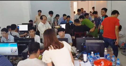 Police examine a company operating one of the loan shark apps in Ho Chi Minh City, Vietnam in this supplied photo.