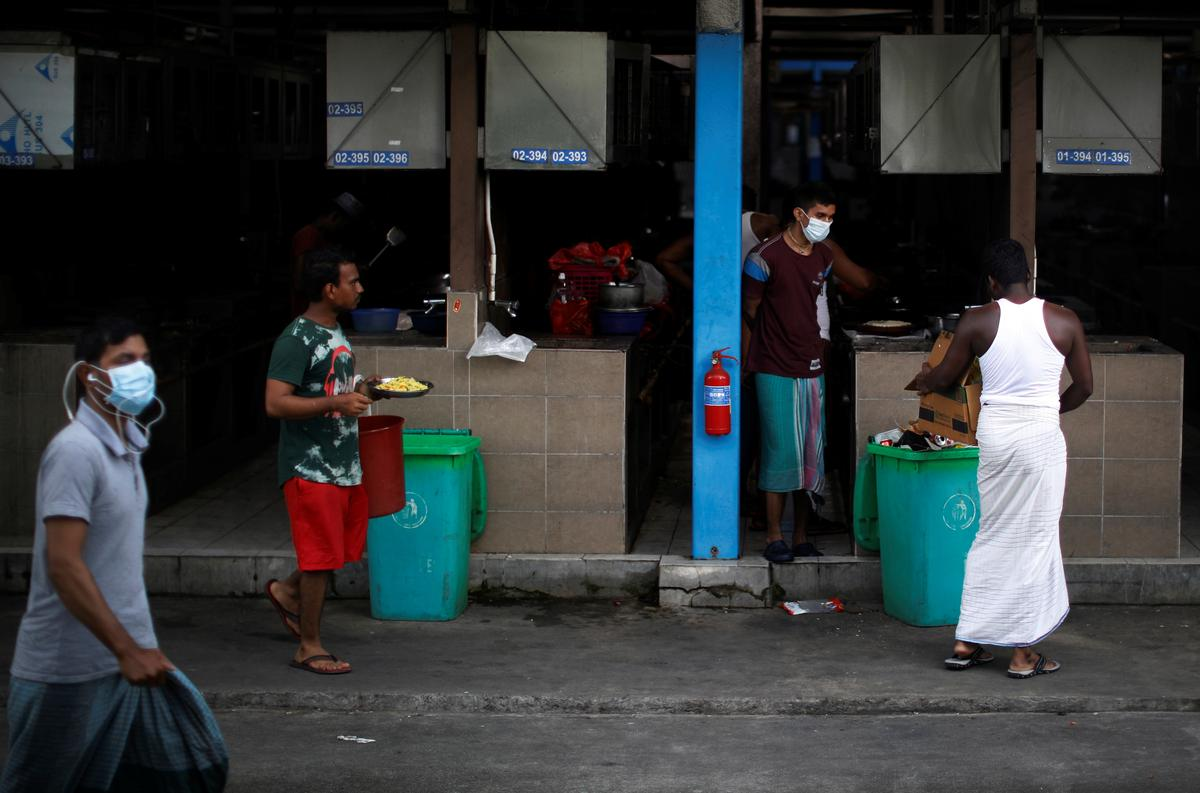 FILE PHOTO: Migrant workers are seen at S11 Punggol migrant workers' dormitory during the coronavirus outbreak (COVID-19) in Singapore April 6, 2020. Photo: Reuters