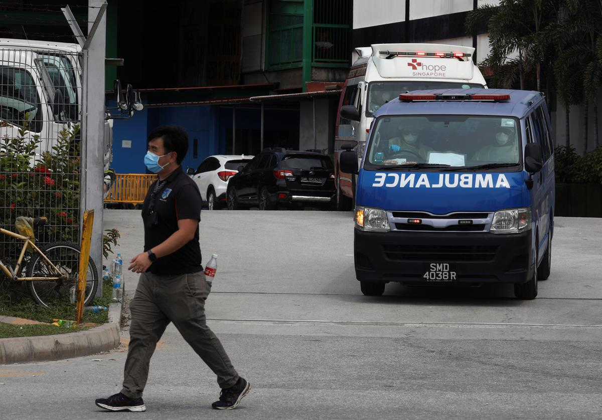 FILE PHOTO: Ambulances leave the Punggol S11 migrant workers' dormitory during the coronavirus outbreak (COVID-19) in Singapore April 6, 2020.   Photo: Reuters