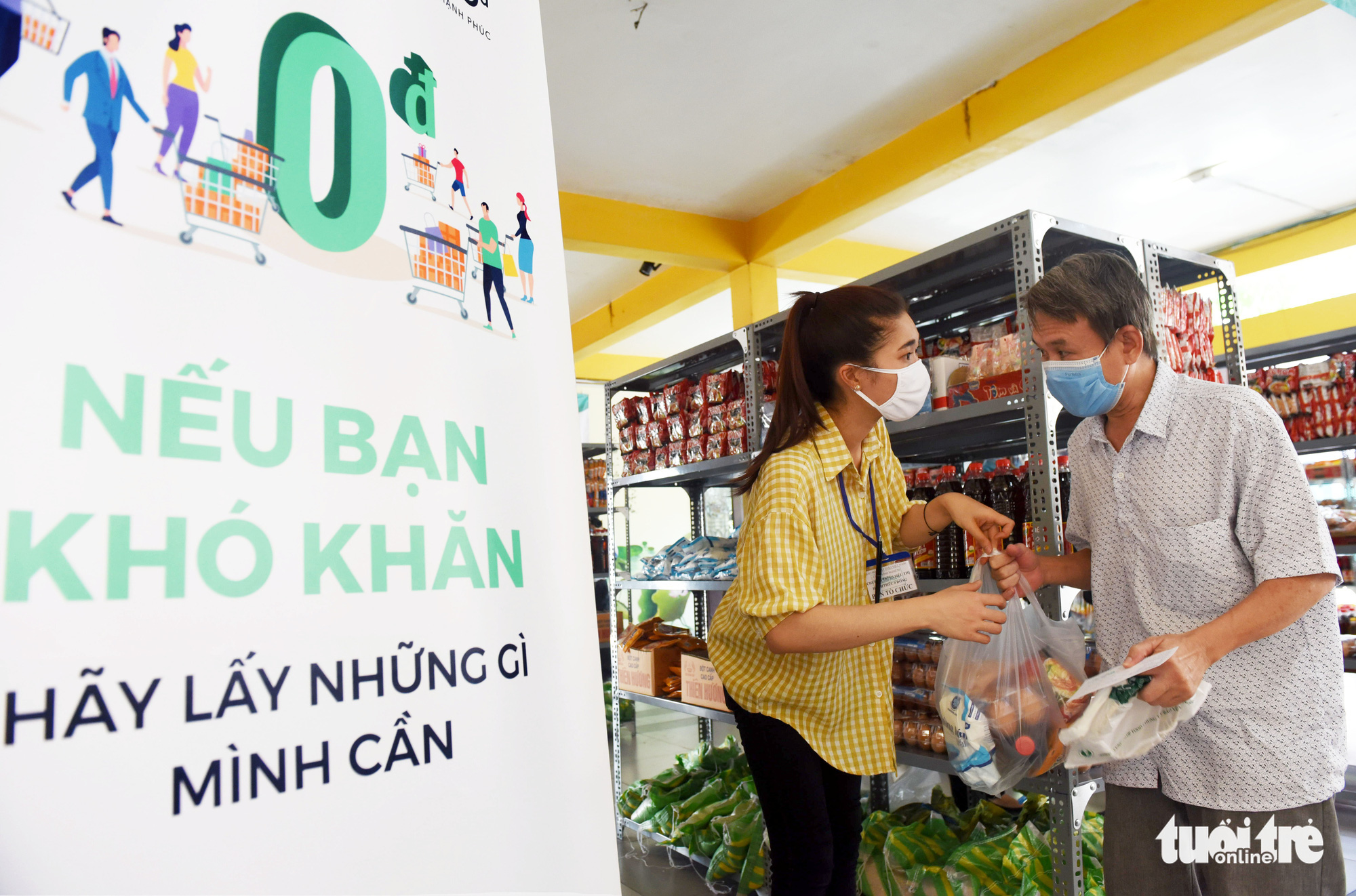 A standee with the Vietnamese motto that translates to 'Take if you are in need. Leave for others if you are doing well.' is seen at the 'Zero-VND Happy Supermarket' located at Vinh Nghiem Pagoda in District 3, Ho Chi Minh City, Vietnam Photo: Duyen Phan / Tuoi Tre