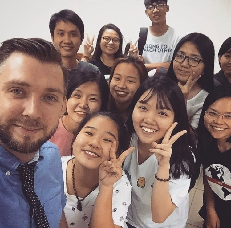 John Dewhirst (L) is seen with his students in a photo he provided Tuoi Tre News, taken before the COVID-19 causing schools and educational institutes in Vietnam to close.