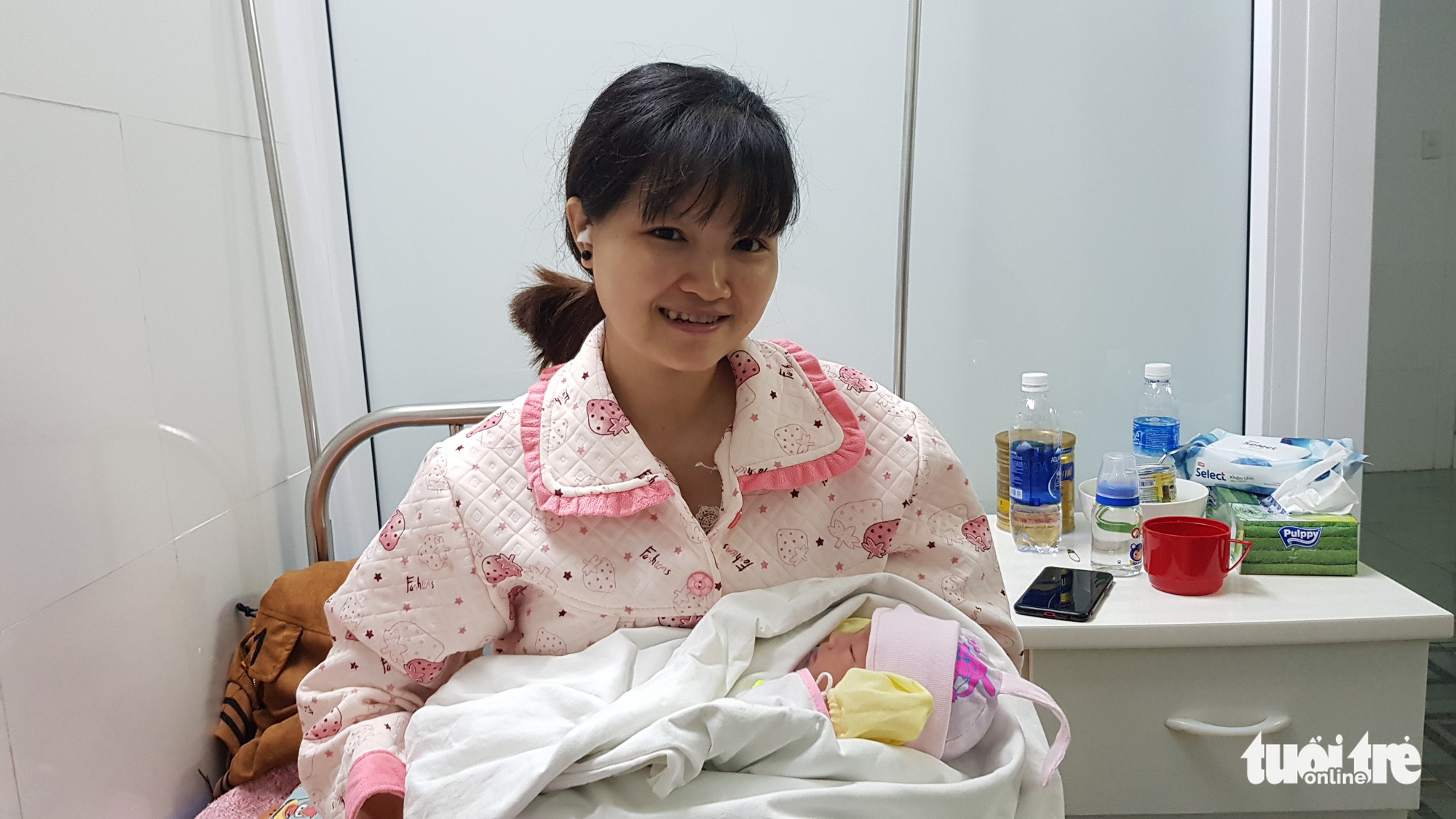 Lang Thi Mau and her newborn are seen at Hue Transport Hospital in Thue Thien – Hue Province, Vietnam in this photo supplied by the train crew who helped her deliver the baby.