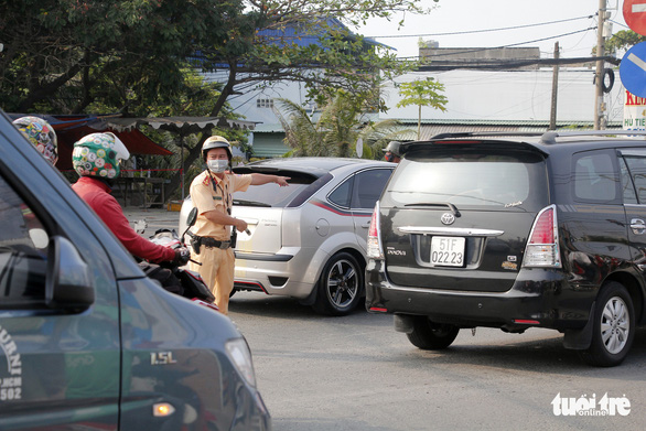 A traffic police officer directs the traffic on a street leading to theHo Chi Minh City-Trung LuongExpressway in southern Vietnam, April 30, 2020. Photo: Chau Tuan / Tuoi Tre