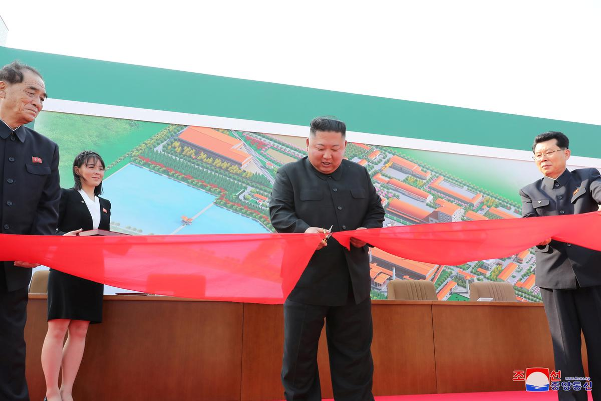 North Korean leader Kim Jong Un attends the completion of a fertilizer plant, together with his younger sister Kim Yo Jong, in a region north of the capital, Pyongyang, in this image released by North Korea's Korean Central News Agency (KCNA) on May 2, 2020. Photo: KCNA via Reuters
