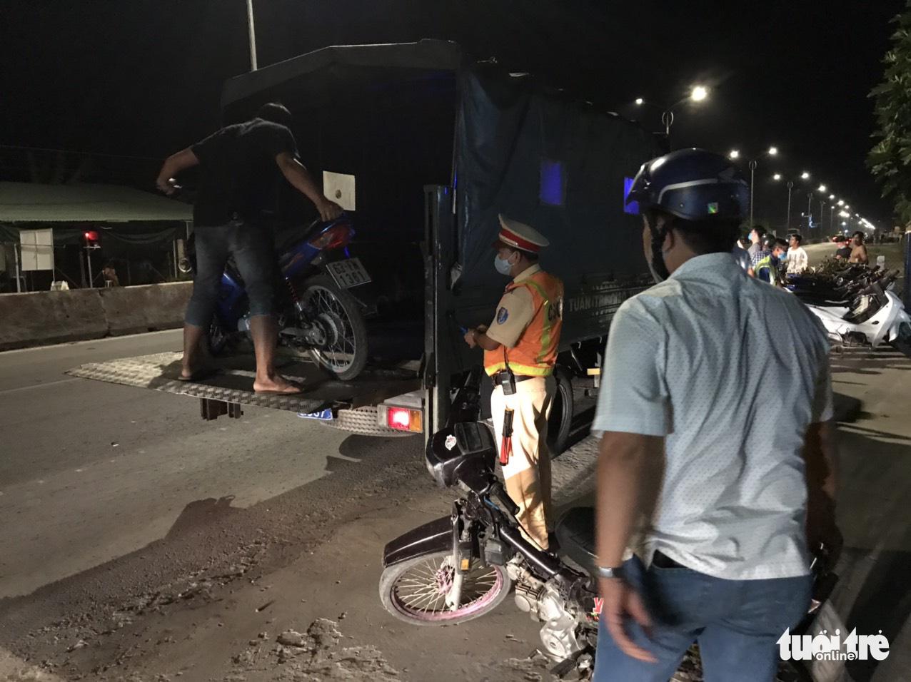 Policeman suffers brain hemorrhage, broken leg after being hit by street racer in Vietnam
