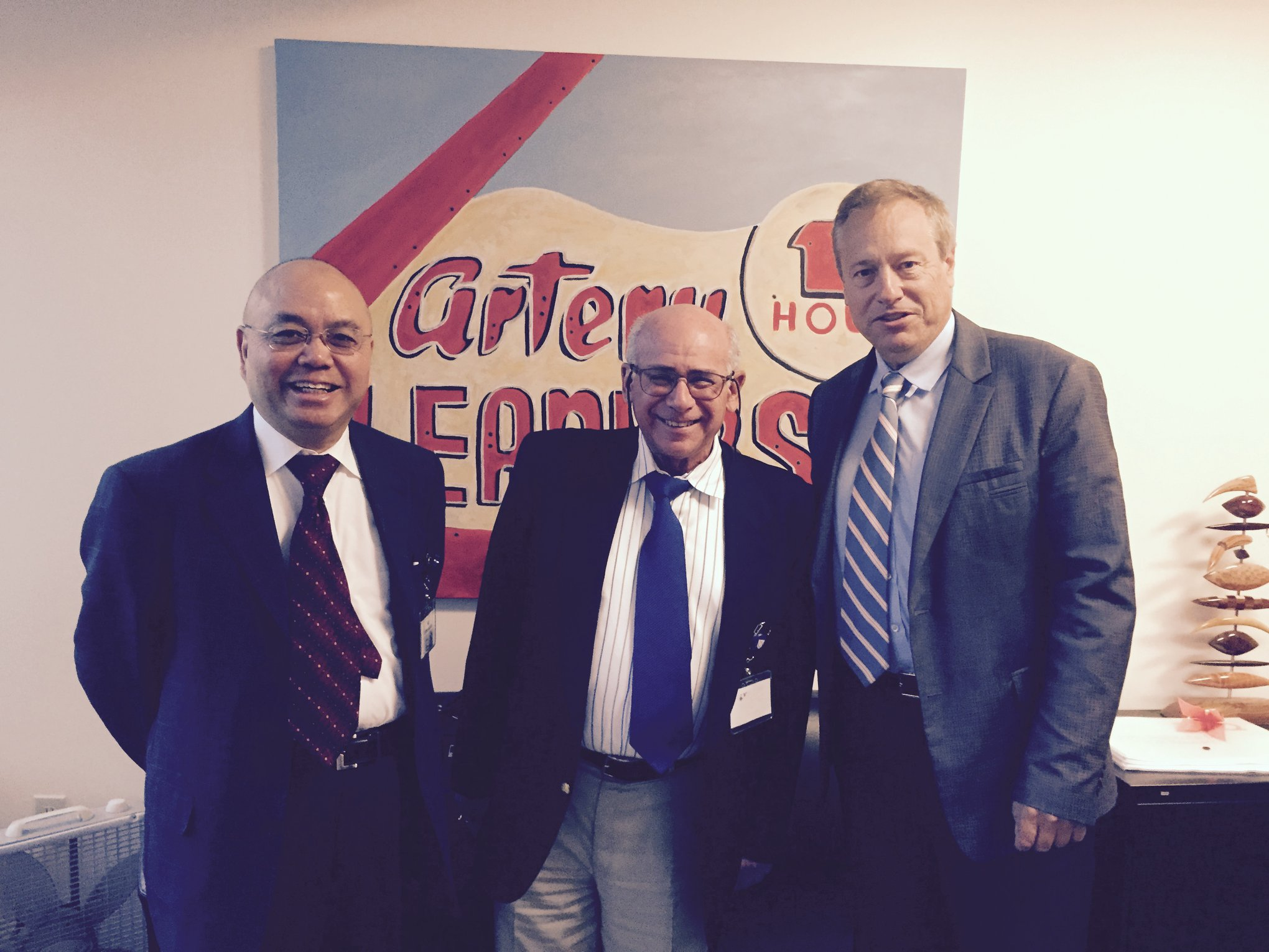 Prof. Thach Nguyen (left), Steven Korn, and Prof. Michael Gibson at Gibson's office in Boston.