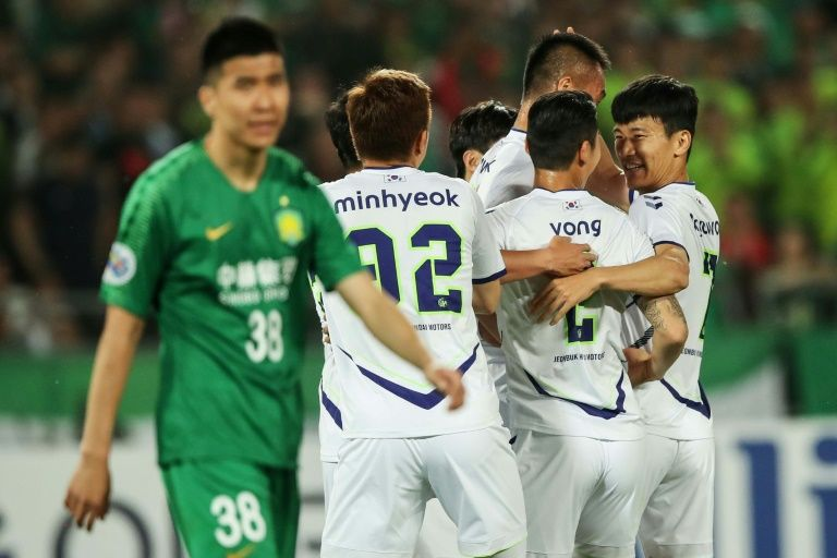 Players have been urged not to celebrate goals with their teammates. Photo: AFP