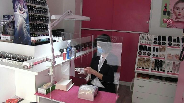 Margherita Borgo, the owner of a beauty center in Milan, a profession that has not yet been allowed by the Italian government to resume work, is seen in this photo. Photo: AFP